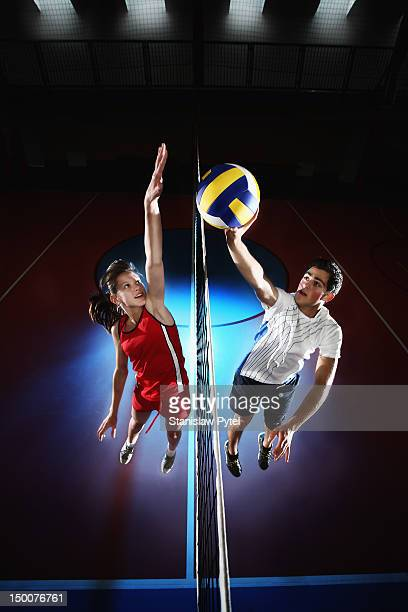 Girl and boy playing volleyball