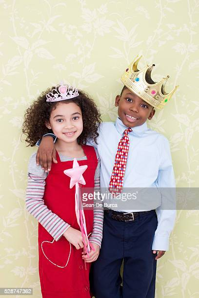 Girl and Boy Wearing Crowns
