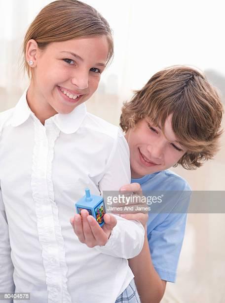 Girl and boy with dreidel