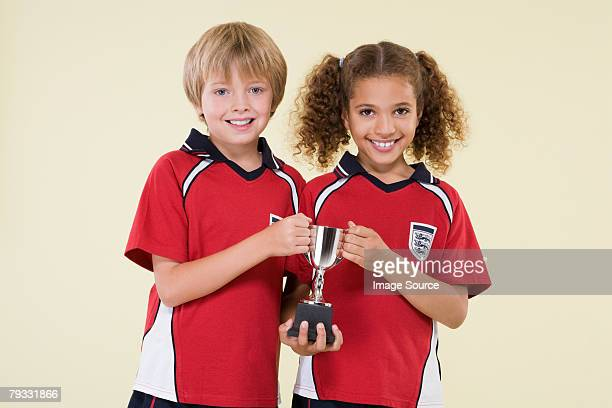 Girl and boy with trophy