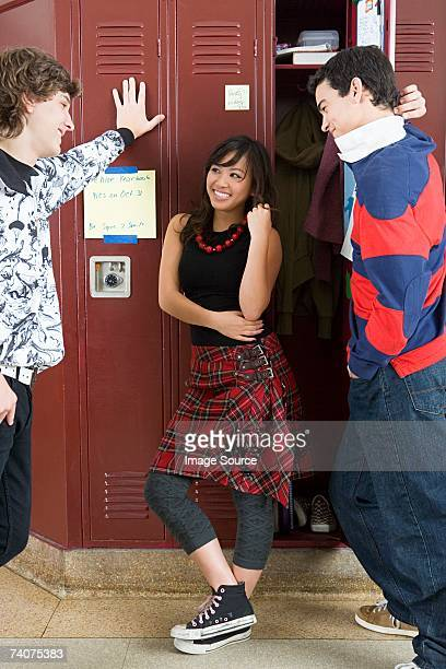 Girl and boys by lockers