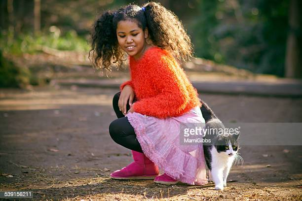 girl and cat are play with park - mamigibbs stock photos and pictures