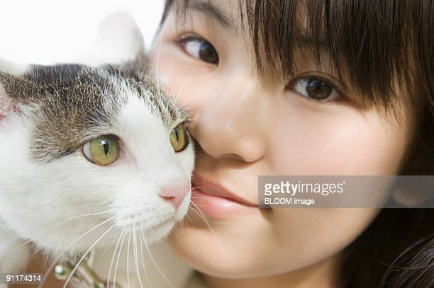 Girl and cat, portrait, close-up