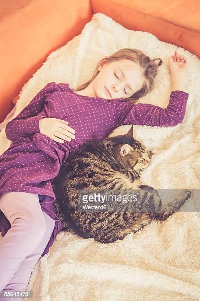 Girl and cat sleeping