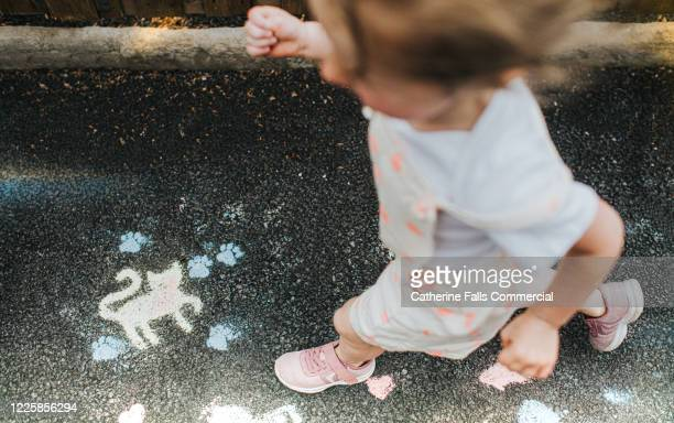 girl and chalk doodles - temporary stock pictures, royalty-free photos & images