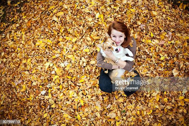 girl and corgi puppy in autumn - americas next top dog stock pictures, royalty-free photos & images