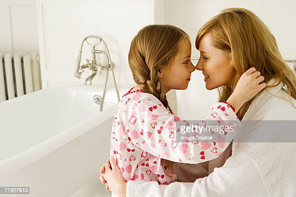 Girl and daughter rubbing noses