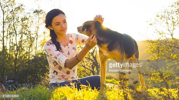 Girl and dog at Sunset in Mountain