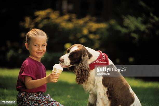 girl and dog eating her ice cream - dog eats out girl stock pictures, royalty-free photos & images
