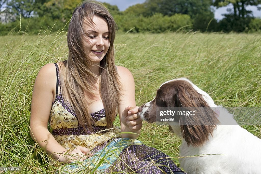 girl and dog in country setting : Stock Photo