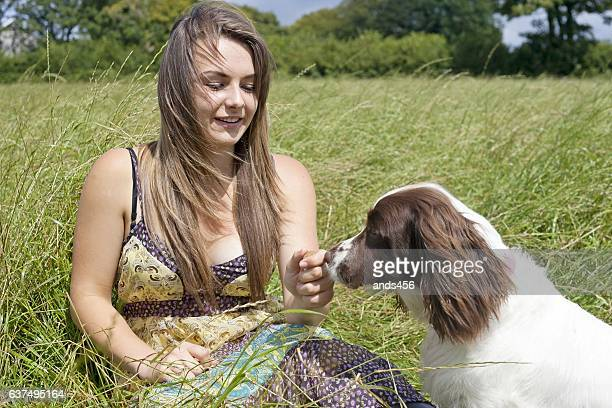 girl and dog in country setting
