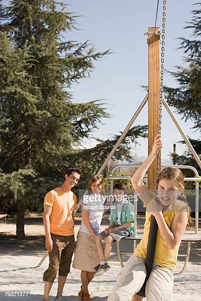 Girl and family in playground
