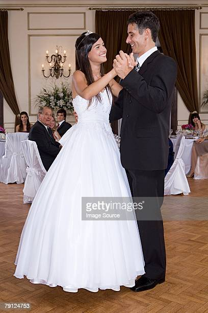 Girl and father dancing at quinceanera