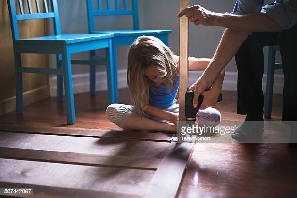 Girl and Father fixing a table