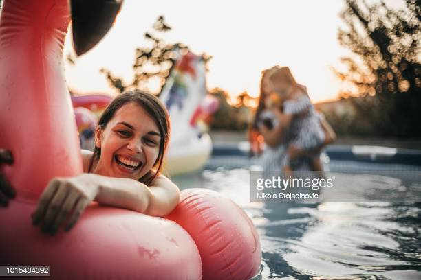 girl and flamingos rubber pool - pool party stock pictures, royalty-free photos & images