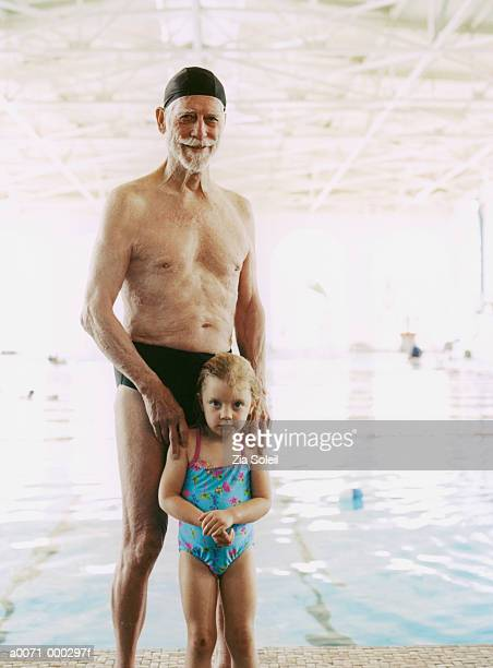 girl and grandfather by pool - zia e nipote foto e immagini stock