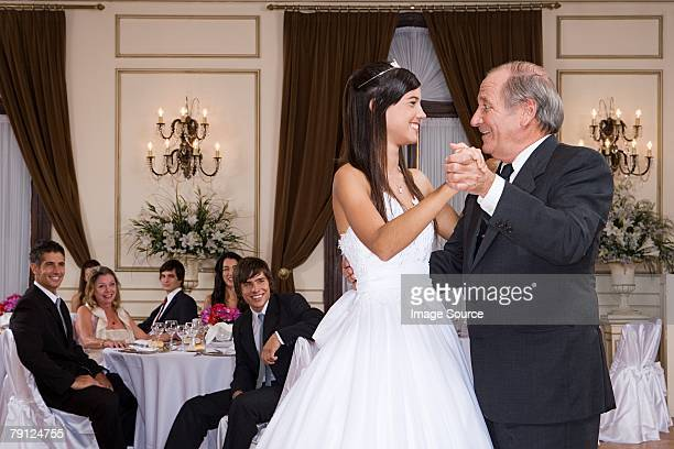 Girl and grandfather dancing at quinceanera