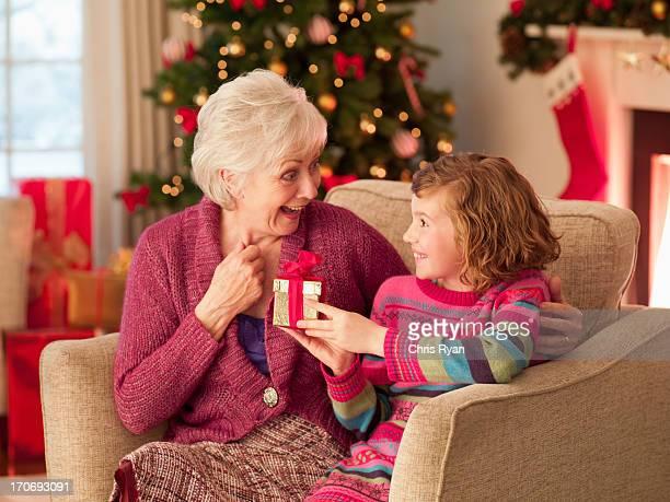 Girl and grandmother holding Christmas gift