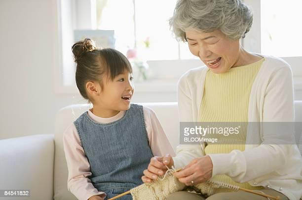 Girl and grandmother knitting