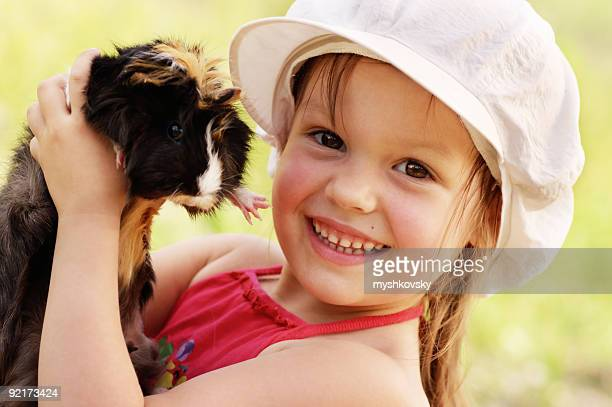 Girl and guinea-pig.