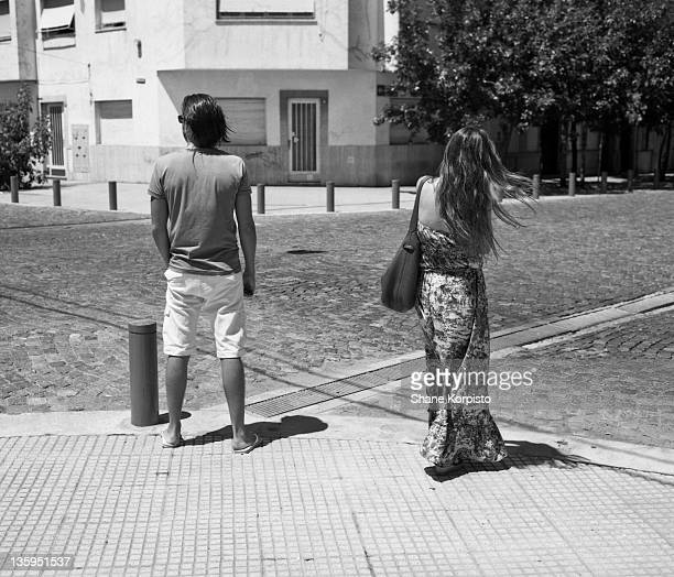 Girl and guy standing on street corner