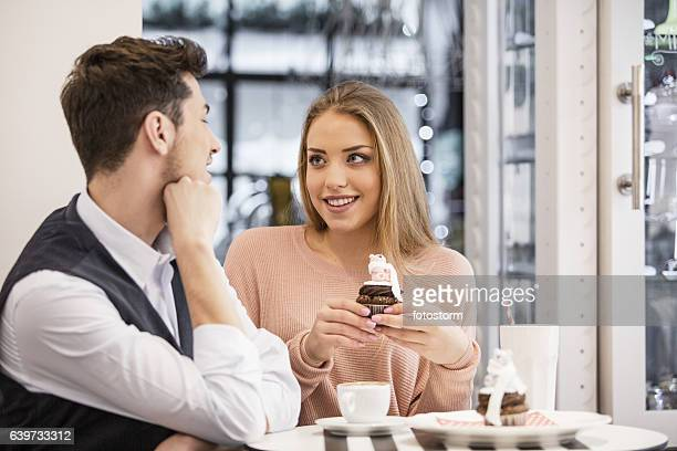 Girl and her boyfriend at the pastry shop