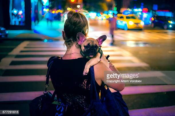 A girl and her dog at night