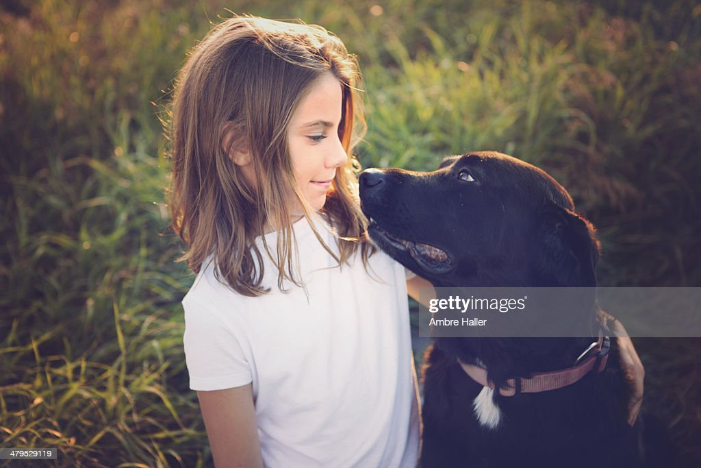 A girl and her dog : Stock Photo