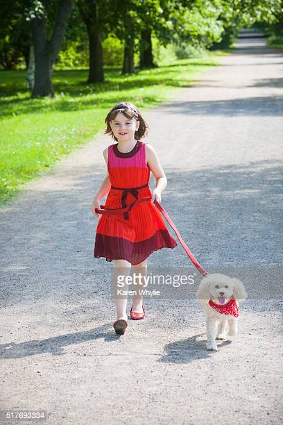 girl and her dog - miniature poodle stock photos and pictures