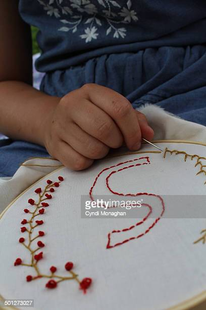 girl and her embroidery - letter s stock photos and pictures