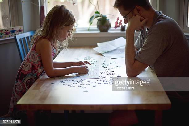 Girl and Her Father Working Puzzle