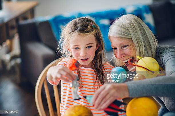 girl and her grandma exploring space - mercury planet stock photos and pictures