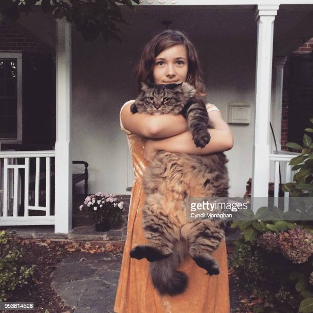 a girl and her maine coon cat - hairy girl stock pictures, royalty-free photos & images