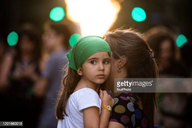 A girl and her mother attend a demonstration to demand the Right to Legal Safe and Free Abortion outside the National Congress on February 19 2020 in...
