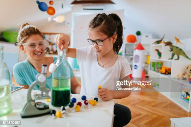 Girl and her mother doing scientific experiment