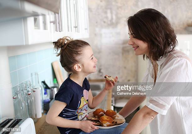 A girl and her mum in the kitchen