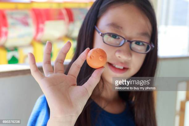 Girl and her new Capsule Toy (Japanese: Gashapon)