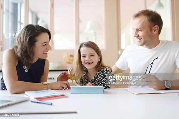 a girl and her parents having fun at home - famiglia con figlio unico foto e immagini stock
