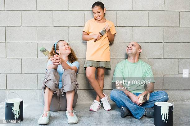 Girl and Her Parents Ready to Paint a Wall