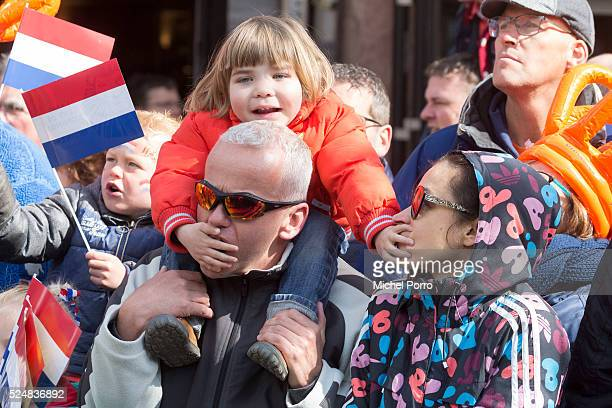 Girl and her parents wait for King Willem-Alexander and Queen Maxima of The Netherlands to arrive for celebrations marking King's Day on April 27,...