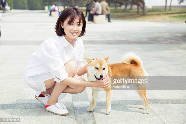 girl and her pet dog - hairy little girls stock photos and pictures