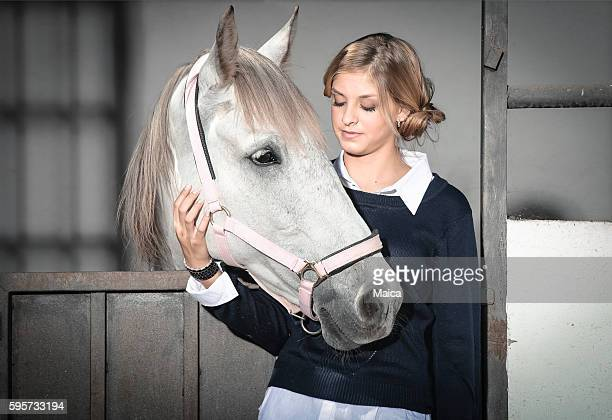 Girl and horse at stable