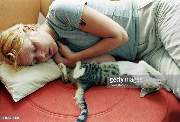 Girl and kitten sleeping