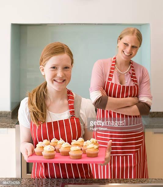 girl and mother making cupcakes - hugh sitton bildbanksfoton och bilder