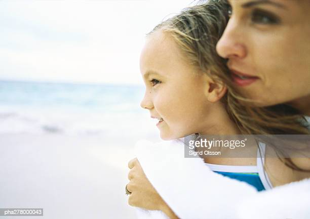 Girl and mother on beach