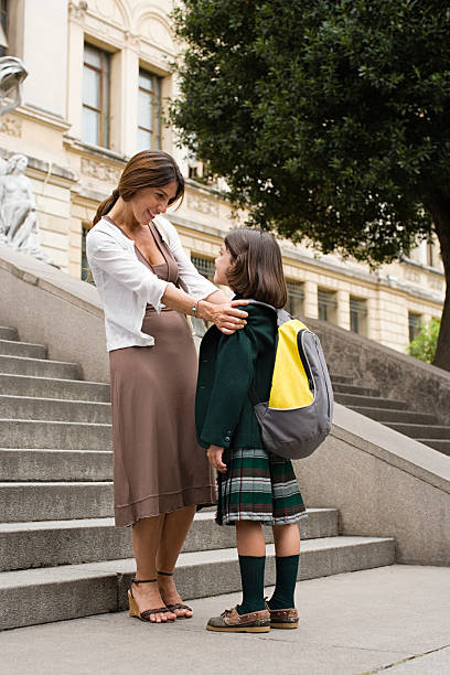 Girl and mother outside school