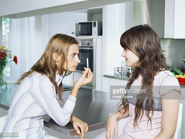 girl and mother with cigarette - little girl smoking cigarette stock photos and pictures