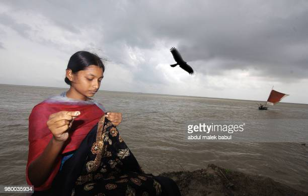 girl and river - bangladeshi beautiful girl stock photos and pictures