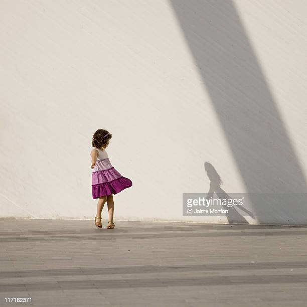 girl and shadow - human limb stock pictures, royalty-free photos & images