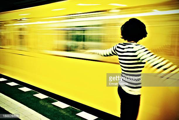 Girl and subway train passing